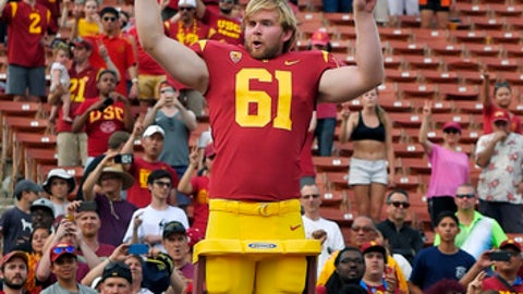 Southern California long snapper Jake Olson leads the USC Trojan Marching Band following an NCAA college football game against Western Michigan, Saturday, Sept. 2, 2017, in Los Angeles. Olson lost his sight eight years ago to a rare form of retinal cancer, but joined the USC team on a scholarship for disabled athletes and began practicing with the Trojans 2 years ago. (AP Photo/Mark J. Terrill)