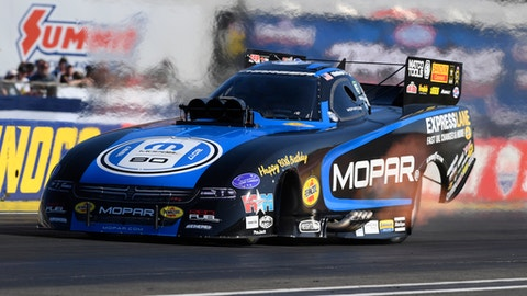 In this photo provided by the NHRA, Matt Hagan set both ends of the Funny Car track record on Friday of the Chevrolet Performance U.S. Nationals, the worlds biggest drag race, at Lucas Oil Raceway at Indianapolis. Hagan ran a 3.799-second pass at 338.77 mph during the first of three qualifying days and first of five qualifying sessions. (Marc Gerwetz/NHRA via AP)