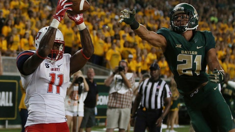 Liberty wide receiver Antonio Gandy-Golden, left, pulls down a touchdown pass over Baylor safety Davion Hall, right, in the first second of an NCAA college football game, Saturday, Sept. 2, 2017, in Waco, Texas. (Rod Aydelotte/Waco Tribune Herald, via AP)