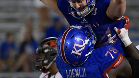 Kansas tight end Ben Johnson (84) celebrates his third quarter touchdown with Kansas offensive lineman Hakeem Adeniji (78) during the second half of an NCAA college football game in Lawrence, Kan., Saturday, Sept. 2, 2017. (AP Photo/Reed Hoffmann)