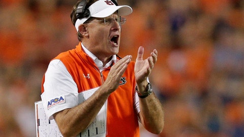Auburn head coach Gus Malzahn claps to get his players attention in the second half of an NCAA college football game against Georgia Southern, Saturday, Sept. 2, 2017, in Auburn, Ala. Auburn won 41-7. (AP Photo/Brynn Anderson)