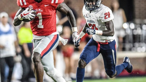 Mississippi wide receiver A.J. Brown (1) runs away from South Alabama cornerback Darian Mills (21) to score on a 71 yard pass play during an NCAA college football game in Oxford, Miss., Saturday, Sept. 2, 2017. (Bruce Newman/Oxford Eagle via AP)