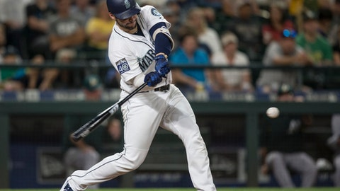 Seattle Mariners' Mike Zunino hits a solo home run off of Oakland Athletics relief pitcher Chris Hatcher during the eighth inning of a baseball game Saturday, Sept. 2, 2017, in Seattle. (AP Photo/Stephen Brashear)