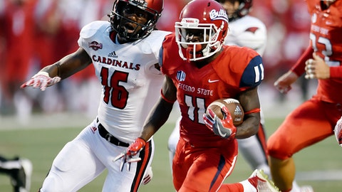 Incarnate Word's Daryl Brooks, left, chases Fresno State's DeJonte O'Neal during an NCAA college football game Saturday, Sept. 2, 2017, in Fresno, Calif. (Eric Paul Zamora/The Fresno Bee via AP)
