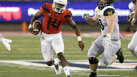 Arizona quarterback Khalil Tate (14) runs for a first down against Northern Arizona in the second half during an NCAA college football game, Saturday, Sept. 2, 2017, in Tucson, Ariz. (AP Photo/Rick Scuteri)