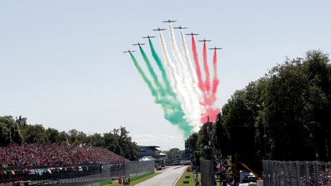 The Frecce Tricolori acrobatic squad fly over the track prior to the Italian Formula One Grand Prix, at the Monza racetrack, Italy, Sunday, Sept. 3, 2017. (AP Photo/Antonio Calanni)