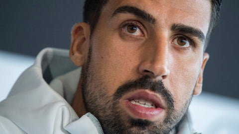 German player Sami Khedira attends  a press conference  prior Monday's group C World Cup qualification soccer match against Norway,  at the Mercedes Benz Museum in Stuttgart, Germany, Sunday, Sept. 3, 2017.  (Sebastian Gollnow/dpa via AP)