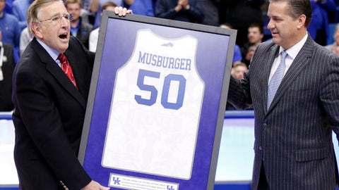 "FILE - In this  Jan. 31, 2017, file photo, veteran broadcaster Brent Musburger, left, is presented with a framed jersey in honor of his retirement by Kentucky head coach John Calipari prior to an NCAA college basketball game between Kentucky and Georgia, in Lexington, Ky. You are looking live _ at the 50th year of ""The NFL Today."" That catch phrase for the CBS pregame show dates back to the days of Brent Musburger as host. James Brown has that role now, and was preceded by the likes of Frank Gifford, Jack Whitaker, Pat Summerall and Greg Gumbel. (AP Photo/James Crisp, File)"