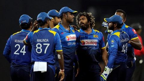 Sri Lanka's Lasith Malinga, third right without cap, celebrates with teammates the dismissal of India's Ajinkya Rahane during their fifth and last one-day international cricket match in Colombo, Sri Lanka, Sunday, Sept. 3, 2017. (AP Photo/Eranga Jayawardena)