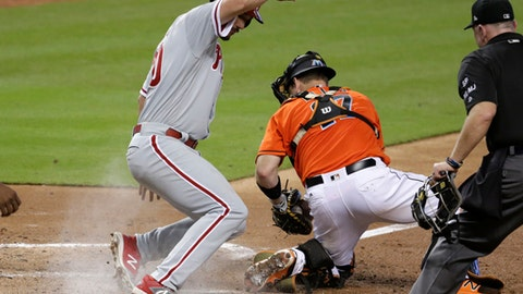 Philadelphia Phillies' Cameron Perkins (30) beats the throw to Miami Marlins catcher A.J. Ellis to score on a single hit by Cesar Hernandez during the fifth inning of a baseball game, Sunday, Sept. 3, 2017, in Miami. (AP Photo/Lynne Sladky)