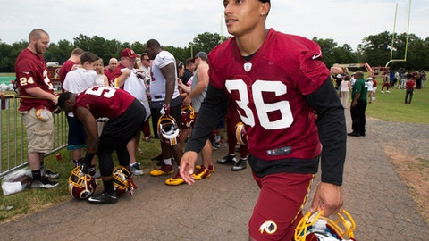 This June 15, 2016 photo shows Washington Redskins' safety Su'a Cravens walking from the field during the NFL football teams minicamp at the Redskins Park in Ashburn, Va. Cravens had to be talked out of retiring on Sunday, Sept. 3, 2017 during a meeting with team president Bruce Allen, and his future with the team is in doubt. (AP Photo/Manuel Balce Ceneta)