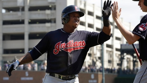 Cleveland Indians' Jose Ramirez is greeted after his two-run home run during the sixth inning of a baseball game against the Detroit Tigers, Sunday, Sept. 3, 2017, in Detroit. (AP Photo/Carlos Osorio)