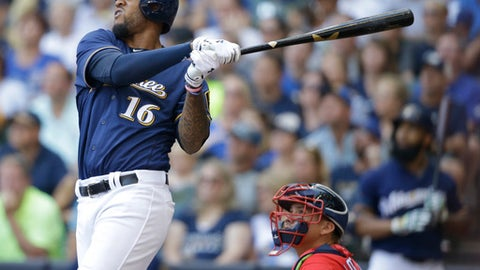 Milwaukee Brewers' Domingo Santana watches his two-RBI home run against the Washington Nationals during the fourth inning of a baseball game, Sunday, Sept. 3, 2017, in Milwaukee. (AP Photo/Jeffrey Phelps)