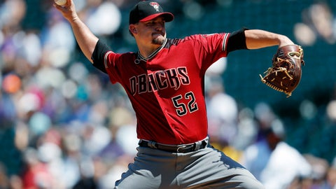 Arizona Diamondbacks starting pitcher Zack Godley delivers a pitch to Colorado Rockies' Carlos Gonzalez in the first inning of a baseball game Sunday, Sept. 3, 2017, in Denver. (AP Photo/David Zalubowski)