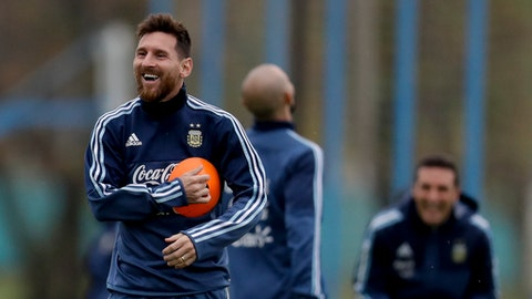 Argentina's Lionel Messi smiles during a training session in preparation for a 2018 Russia World Cup qualifying soccer match against Venezuela, in Buenos Aires, Argentina, Sunday, Sept. 3, 2017. (AP Photo/Natacha Pisarenko)