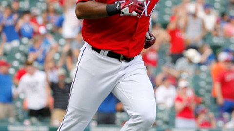 Texas Rangers' Elvis Andrus looks into his team dugout after as he runs the bases after hitting a two-run home run off of Los Angeles Angels' Keynan Middleton in the sixth inning of a baseball game, Sunday, Sept. 3, 2017, in Arlington, Texas. (AP Photo/Tony Gutierrez)