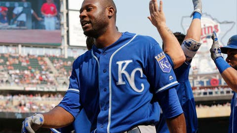 Kansas City Royals' Lorenzo Cain arrives in the dugout after his his two-run triple off Minnesota Twins pitcher Alan Busenitz in the seventh inning of a baseball game Sunday, Sept, 3, 2017, in Minneapolis. The Royals won 5-4. (AP Photo/Jim Mone)