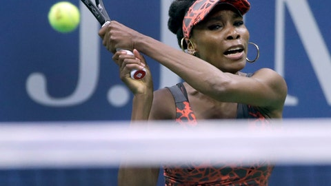 Venus Williams, of the United States, returns a shot from Carla Suarez-Navarro, of Spain, during the fourth round of the U.S. Open tennis tournament, Sunday, Sept. 3, 2017, in New York. (AP Photo/Frank Franklin II)
