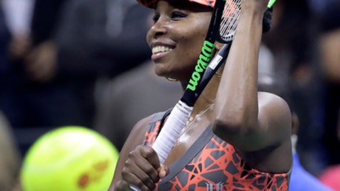 Venus Williams, of the United States, waves to fans after beating Carla Suarez-Navarro, of Spain, during the fourth round of the U.S. Open tennis tournament, Sunday, Sept. 3, 2017, in New York. (AP Photo/Frank Franklin II)