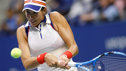 Garbine Muguruza, of Spain, returns the ball in a fourth round match against Petra Kvitova, of the Czech Republic, at the U.S. Open tennis tournament in New York, Sunday, Sept. 3, 2017. (AP Photo/Kathy Willens)