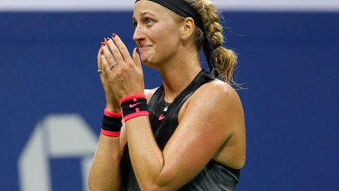 Petra Kvitova, of the Czech Republic, reacts after defeating Garbine Muguruza, of Spain, 7-6 (3), 6-3, in straight sets in their fourth-round match at the U.S. Open tennis tournament in New York, Sunday, Sept. 3, 2017. (AP Photo/Kathy Willens)