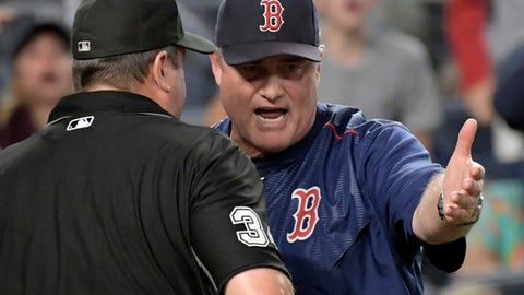 Boston Red Sox manager John Farrell talks with home plate umpire Sam Holbrook during the sixth inning of a baseball game against the New York Yankees, Sunday, Sept. 3, 2017, at Yankee Stadium in New York. (AP Photo/Bill Kostroun)