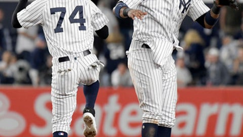 New York Yankees' Starlin Castro and Ronald Torreyes (74) celebrate after the Yankees defeated the Boston Red Sox 9-2 in a baseball game Sunday, Sept.3, 2017, at Yankee Stadium in New York. (AP Photo/Bill Kostroun)
