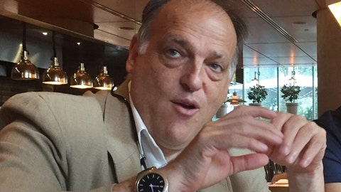 "FILE - In this file photo dated  Saturday, July 29, 2017, LaLiga president Javier Tebas speaks to reporters in Miami, USA.  Tebas said in a statement to The Associated Press on Monday Sept. 4, 2017, that Abu Dhabi-funded Manchester City and Qatari-owned PSG are benefiting from state aid which distorts European competitions and ""is irreparably harming the football industry.""(AP Photo/Gisela Salomon, FILE)"