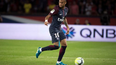 FILE - In this file photo dated Friday, Aug. 25, 2017, PSG's Neymar during the French League One soccer match between Paris Saint Germain and Saint Etienne at the Parc des Princes stadium in Paris, France. The French capital club PSG broke the world record fee to sign Neymar from Barcelona for 222 million euros ($262 million).  (AP Photo/Kamil Zihnioglu, FILE)