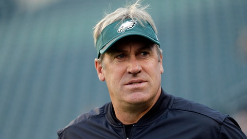 FILE - In this Aug. 24, 2017, file photo, Philadelphia Eagles head coach Doug Pederson walks the field before a preseason NFL football game against the Miami Dolphins, in Philadelphia. Pederson had a so-so year as a first-time head coach in 2016. He made some aggressive calls that backfired and like his mentor, Andy Reid, relied heavily on passing instead of a balanced attack. With a year under his belt calling the shots, Pederson should be more comfortable. (AP Photo/Matt Slocum, File)