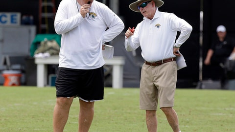 FILE - In this July 28, 2017, file photo, Jacksonville Jaguars head coach Doug Marrone, left, talks with Tom Coughlin, right, executive vice president of football operations, during NFL football training camp in Jacksonville, Fla. Decision-maker Tom Coughlin and new coach Doug Marrone failed to adequately address the team's offensive line, a miscalculation that could lead to less-than-ideal results on the ground and in the win column this season. (AP Photo/John Raoux, File)