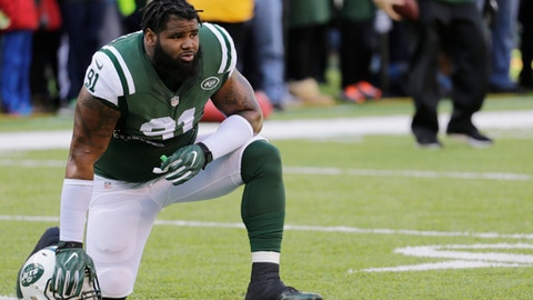 FILE - In this Jan. 1, 2017, file photo, then-New York Jets defensive end Sheldon Richardson (91) stretches prior to an NFL football game against the Buffalo Bills, in East Rutherford, N.J. Seattle appears to be putting extra urgency in this season, highlighted by the acquisition of former Pro Bowl defensive lineman Sheldon Richardson last week. It wasn't a move needed for Seattle to be competitive, but could be a move that is the difference in being a contender and a Super Bowl participant. (AP Photo/Seth Wenig, File)