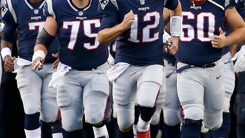 FILE - In this Aug. 10, 2017, file photo, New England Patriots quarterback Tom Brady (12) leads his team onto the field during an NFL preseason football game, in Foxborough, Mass. The Patriots moved into elite company with their fifth Super Bowl title last season, joining the Dallas Cowboys and San Francisco 49ers at five Lombardi trophies each. New England lost a few pieces from their 2016 championship run, but return with a mostly intact lineup, led by what seems like an ageless quarterback in Tom Brady, even at 40 years old. . It makes them to odds on favorite to tie the Pittsburgh Steelers and their record six Super Bowl crowns. (AP Photo/Mary Schwalm, File)