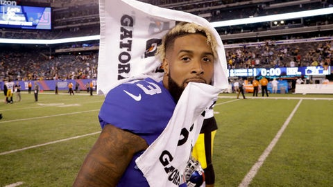 FILE - In this Aug. 11, 2017, file photo, New York Giants wide receiver Odell Beckham (13) walks off the field after a preseason NFL football game against the Pittsburgh Steelers, in East Rutherford, N.J. Eli Manning has an outstanding corps of receivers in Odell Beckham Jr., Brandon Marshall, Sterling Shepard and rookie tight end Evan Engram.(AP Photo/Julio Cortez, File)
