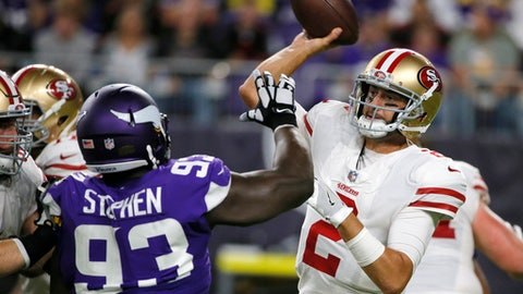 FILE - In this Aug. 27, 2017, file photo, San Francisco 49ers quarterback Brian Hoyer, right, passes over Minnesota Vikings defensive tackle Shamar Stephen (93) during the first half of an NFL preseason football game in Minneapolis. Hoyer is with his sixth team since entering the league in 2009 and wants to show he is more than just a bridge to next offseason when the Niners could target a potential franchise quarterback in either the draft or free agency. (AP Photo/Bruce Kluckhohn, File)