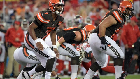 FILE - In this Aug. 26, 2017, file photo, Cleveland Browns quarterback DeShone Kizer (7) calls a play against the Tampa Bay Buccaneers during an NFL preseason football game in Tampa, Fla. Cleveland will hand its offense over to another rookie, quarterback DeShone Kizer, a second-round pick from Notre Dame. He's got the smarts, the pedigree and the arm. All that's missing is experience, and the Browns, who currently have two first-round picks next year, are going to quickly find out if he can handle the gig. (AP Photo/Phelan Ebenhack, File)