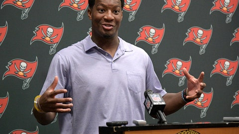 FILE - In this Aug. 17, 2017, file photo, Tampa Bay Buccaneers quarterback Jameis Winston answers a question after an NFL preseason football game against the Jacksonville Jaguars, in Jacksonville, Fla.  The Tampa Bay Buccaneers have lofty expectations and aren't afraid to talk about them. The team hasn't made the playoffs since 2007, but Jameis Winston and teammates feel the team is on the verge of changing that trend. (AP Photo/Phelan M. Ebenhack, File)
