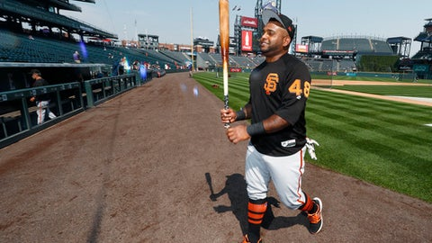 San Francisco Giants third baseman Pablo Sandoval smiles after taking batting practice before facing the Colorado Rockies in a baseball game Monday, Sept. 4, 2017, in Denver.(AP Photo/David Zalubowski)