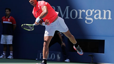 Rafael Nadal, of Spain, serves to Alexandr Dolgopolov, of Ukraine, during the fourth round of the U.S. Open tennis tournament, Monday, Sept. 4, 2017, in New York. (AP Photo/Julie Jacobson)
