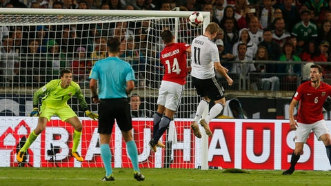 Germany's Timo Werner, center, scores his side's fourth goal during the World Cup Group C qualifying soccer match between Germany and Norway in Stuttgart, Germany, Monday, Sept. 4, 2017. (AP Photo/Michael Probst)