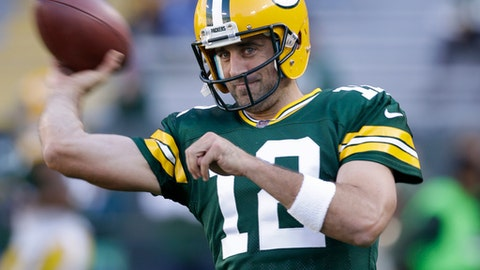 FILE - In this Aug. 31, 2017, file photo,Green Bay Packers' Aaron Rodgers warms up before a preseason NFL football game against the Los Angeles Rams, in Green Bay, Wis. The Green Bay Packers head into the season with familiar expectations as a favorite again to win the NFC North and get to the Super Bowl. Goals will always be set high especially with quarterback Aaron Rodgers in his prime. (AP Photo/Jeffrey Phelps, File)