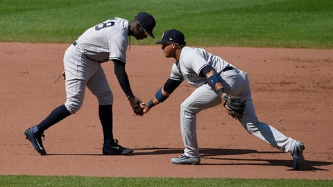 New York Yankees shortstop Didi Gregorius, left, and second baseman Starlin Castro, right, react after a double-play during the fourth inning of a baseball game against the Baltimore Orioles, Monday, Sept. 4, 2017, in Baltimore. (AP Photo/Nick Wass)