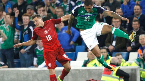 Northern Ireland's Josh Magennis, right, vies for the ball with Czech Republic's Jan Boril during the World Cup Group C qualifying soccer match between Northern Ireland and Czech Republic at Windsor Park, Belfast, Northern Ireland, Monday, Sept. 4, 2017. (AP Photo/Peter Morrison)
