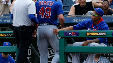 Chicago Cubs starting pitcher Jake Arrieta (49) is accompanied off the field by a trainer in the third inning of a baseball game against the Pittsburgh Pirates in Pittsburgh, Monday, Sept. 4, 2017. (AP Photo/Gene J. Puskar)