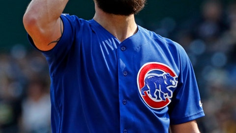 Chicago Cubs starting pitcher Jake Arrieta reacts after giving up a two-run home run to Pittsburgh Pirates' Josh Bell in the first inning of a baseball game in Pittsburgh, Monday, Sept. 4, 2017. (AP Photo/Gene J. Puskar)