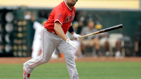 Los Angeles Angels' Albert Pujols runs to first base after hitting an RBI single against the Oakland Athletics in the fourth inning of a baseball game, Monday, Sept. 4, 2017, in Oakland, Calif. (AP Photo/Ben Margot)