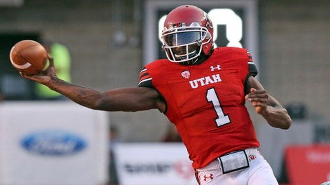 This Aug. 31, 2017 photo shows Utah quarterback Tyler Huntley (1) passing the ball against North Dakota in the second half during an NCAA college football game in Salt Lake City. Utah debuted its new offense run by sophomore Tyler Huntley last week in a win over North Dakota. Huntley flashed his and the system's potential, but both must improve against rival BYU this week. (AP Photo/Rick Bowmer)