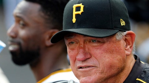 Pittsburgh Pirates manager Clint Hurdle, right, stands in the dugout during a baseball game against the Chicago Cubs in Pittsburgh, Monday, Sept. 4, 2017. (AP Photo/Gene J. Puskar)