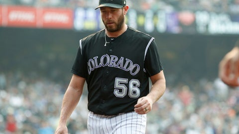 Colorado Rockies relief pitcher Greg Holland heads to the dugout after retiring San Francisco Giants' Hunter Pence in the ninth inning of a baseball game, Monday, Sept. 4, 2017, in Denver. The Rockies won 4-3. (AP Photo/David Zalubowski)
