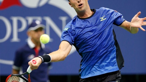 Philipp Kohlschreiber, of Germany, returns in a fourth-round match against Roger Federer, of Switzerland, at the U.S. Open tennis tournament in New York, Monday, Sept. 4, 2017. (AP Photo/Kathy Willens)